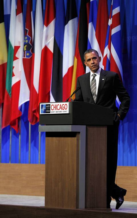 President Barack Obama listens as he takes questions from the media as he has a wrap up press conference at the conclusion of the 2012 NATO Summit at McCormick Place in Chicago.