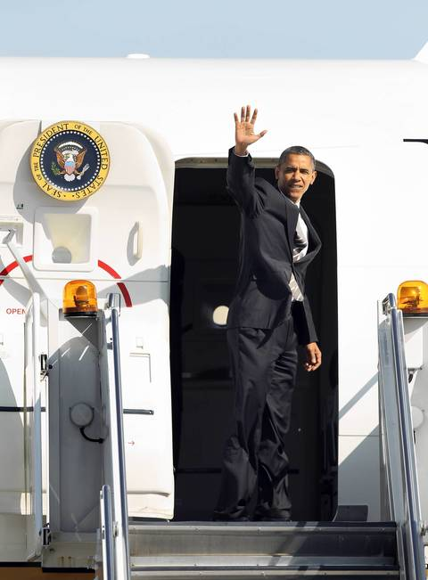 President Barack Obama boards Air Force One as he departs O'Hare International Airport.
