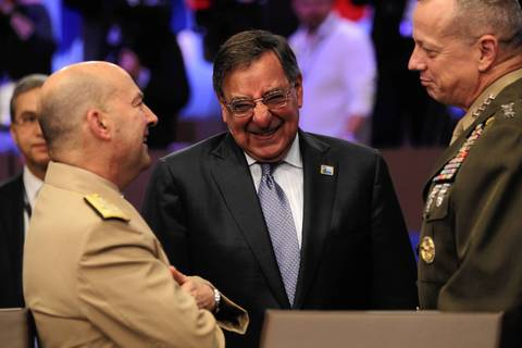 U.S. Defense Minister Leon Panetta, center, meets with other members who comprise the International Security Assistance Force in Afghanistan during the NATO summit at McCormick Place.