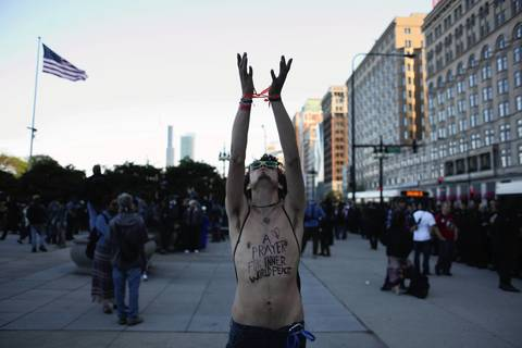 A protester continues in the march on Michigan Avenue.