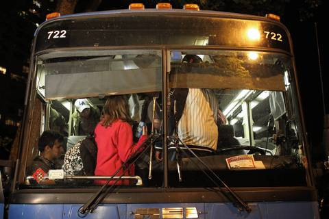 Protesters board a bus to begin their journey home.