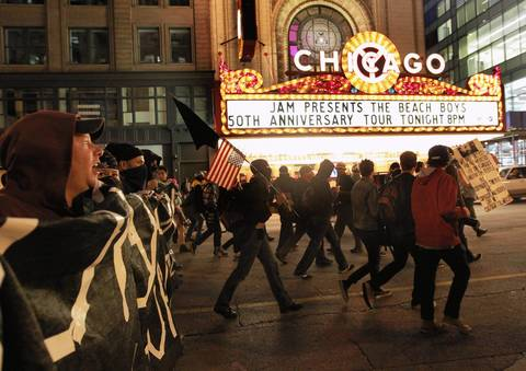 Protesters march on State Street in the Loop late into the evening.