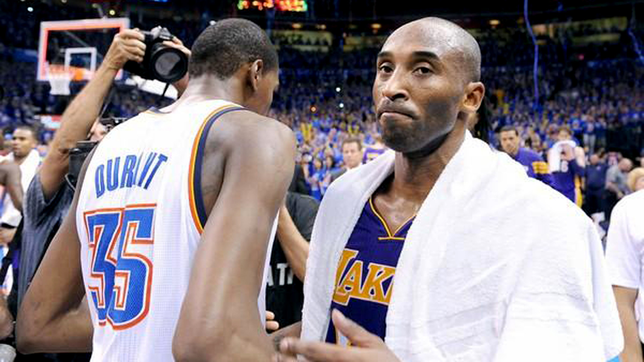 Lakers guard Kobe Bryant leaves the court after congratulating Thunder forward Kevin Durant following a 106-90 loss at Oklahoma City on Monday night.