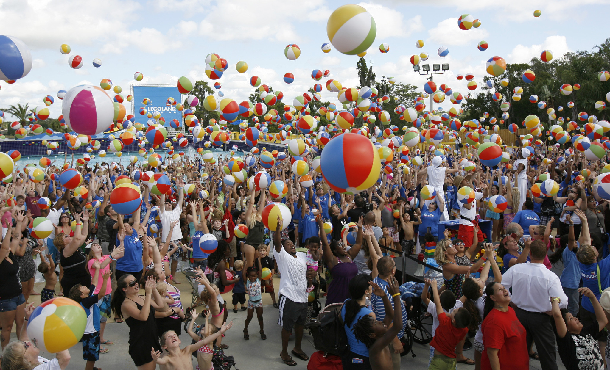 Guests at Legoland's new water park attempt to break a world record by throwing hundreds of beach balls into the air simultaneously during a preview of the park in Winter Haven, Fla. Thursday, May 24, 2012. The grand opening is Saturday, May 26, 2012.
