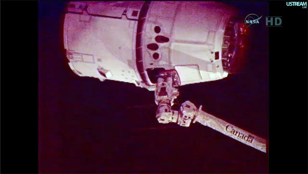 "Just before 10 a.m. Friday, May 25, 2012, the International Space Station's 58-foot robotic arm grabbed the Dragon capsule, which was ""free drifting,"" pacing the space station at 17,000 mph, and made SpaceXNASA's first private space delivery contractor."