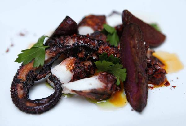 Pulpo Gallego is beer-braised octopus with fingerling potatoes and pimenton served at Racin.