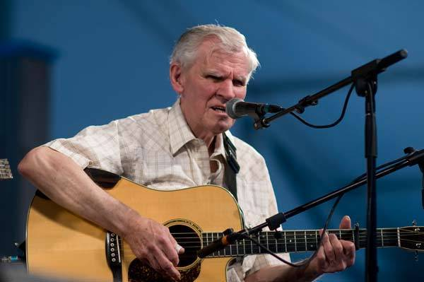 Doc Watson performing on stage at the New Orleans Jazz & Heritage Festival on May 1, 2009.
