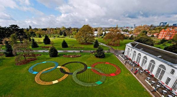 The Olympic rings decorate a lawn at the Royal Botanic Gardens, or Kew, near London. Beginning in July, Englands capital is hosting the Summer Olympics.