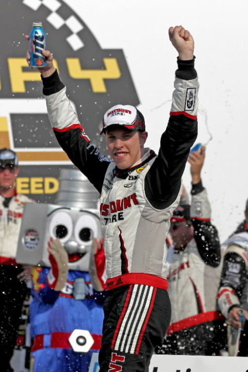 NASCAR Nationwide Series driver Brad Keselowski (22) celebrates winning the History 300 at Charlotte Motor Speedway. (Kevin Liles-US PRESSWIRE)