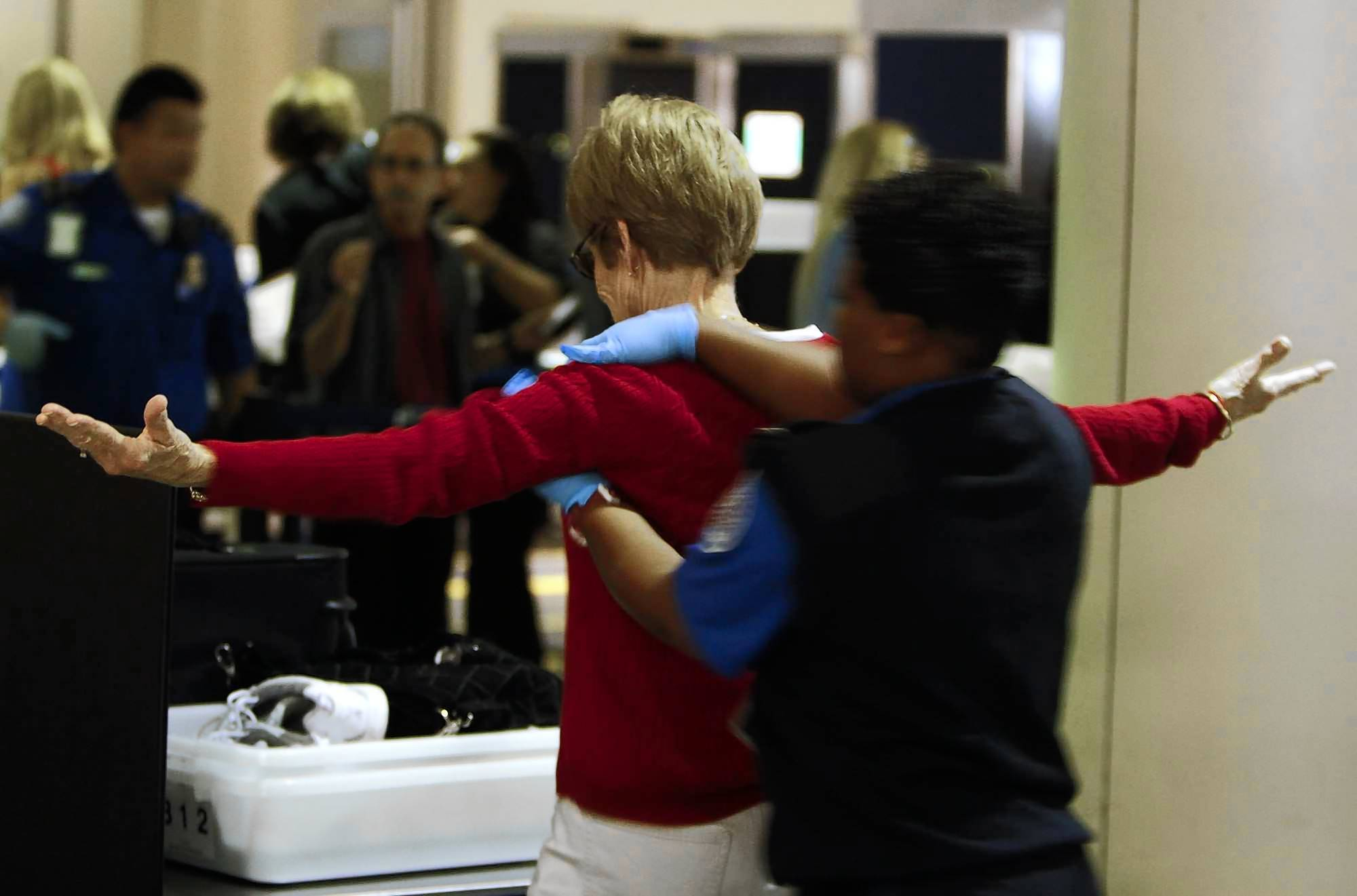 Critics say TSA screeners rely on the pat-down search too often. Above, one such search at Los Angeles International Airport in March.