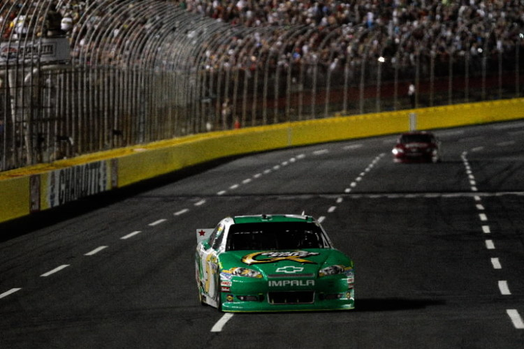Kasey Kahne, driver of the #5 Quaker State Chevrolet, crosses the finish line to win the NASCAR Sprint Cup Series Coca-Cola 600 at Charlotte Motor Speedway on May 27, 2012 in Concord, North Carolina. (Photo by Chris Graythen/Getty Images)