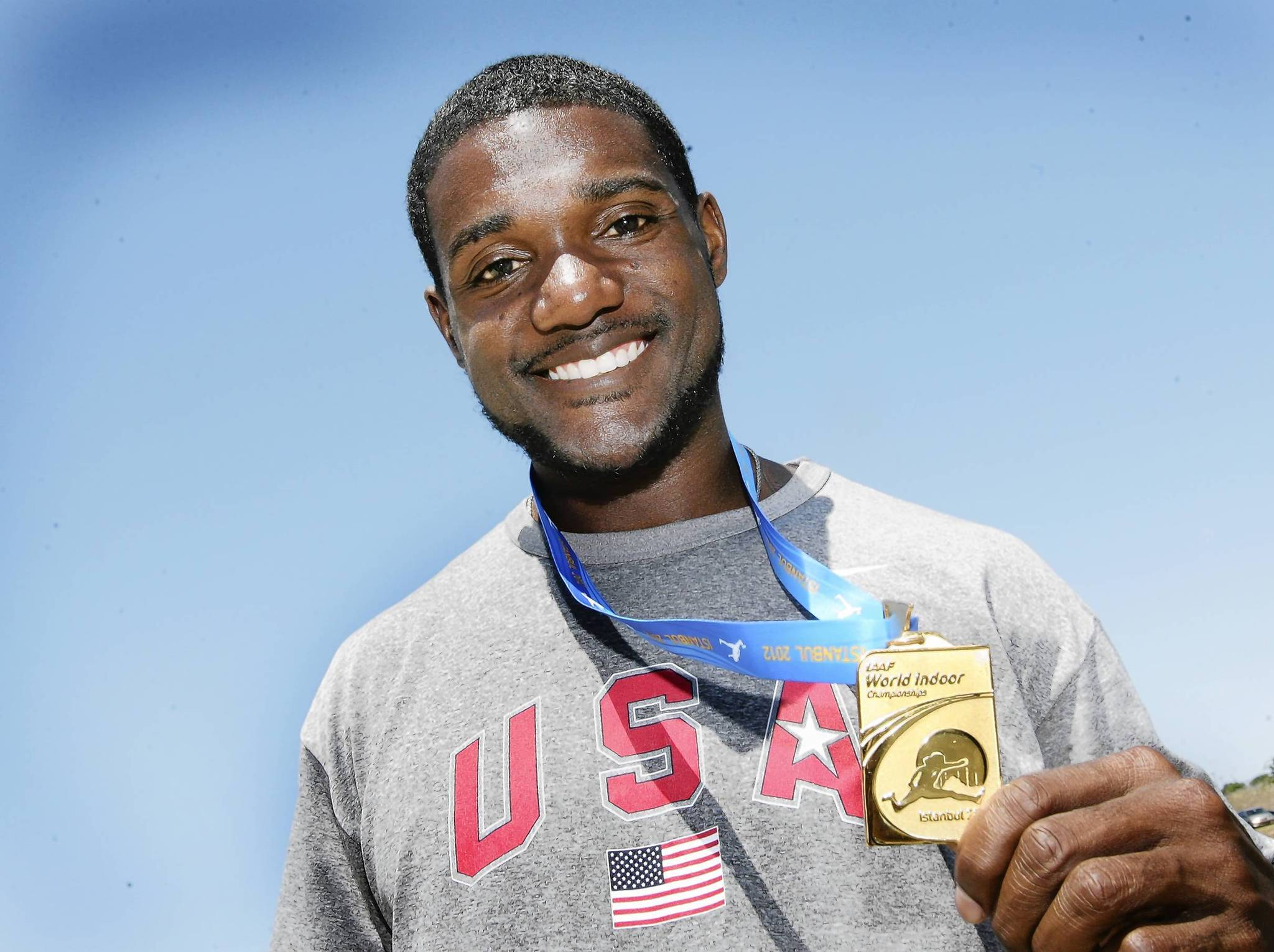 American sprinter Justin Gatlin proudly displays the Gold he won this year in the World Indoor Championships in Istanbul .Twenty five Olympic athletes, training in Clermont, were introduced during a media day at the National Training Center on Friday, April 25, 2012. Earlier his month , Gatlin ran a 9.87 in Doha, Quatar, to beat 100 meter World record holder Asafa Powell in the Diamond League season opener.