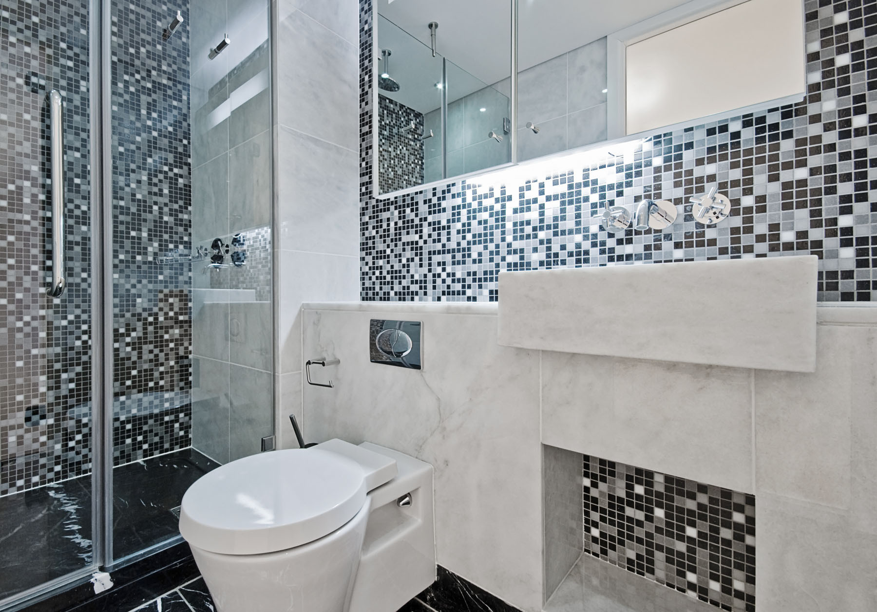 Mixing black, white and gray tile with metal accents adds zing.
