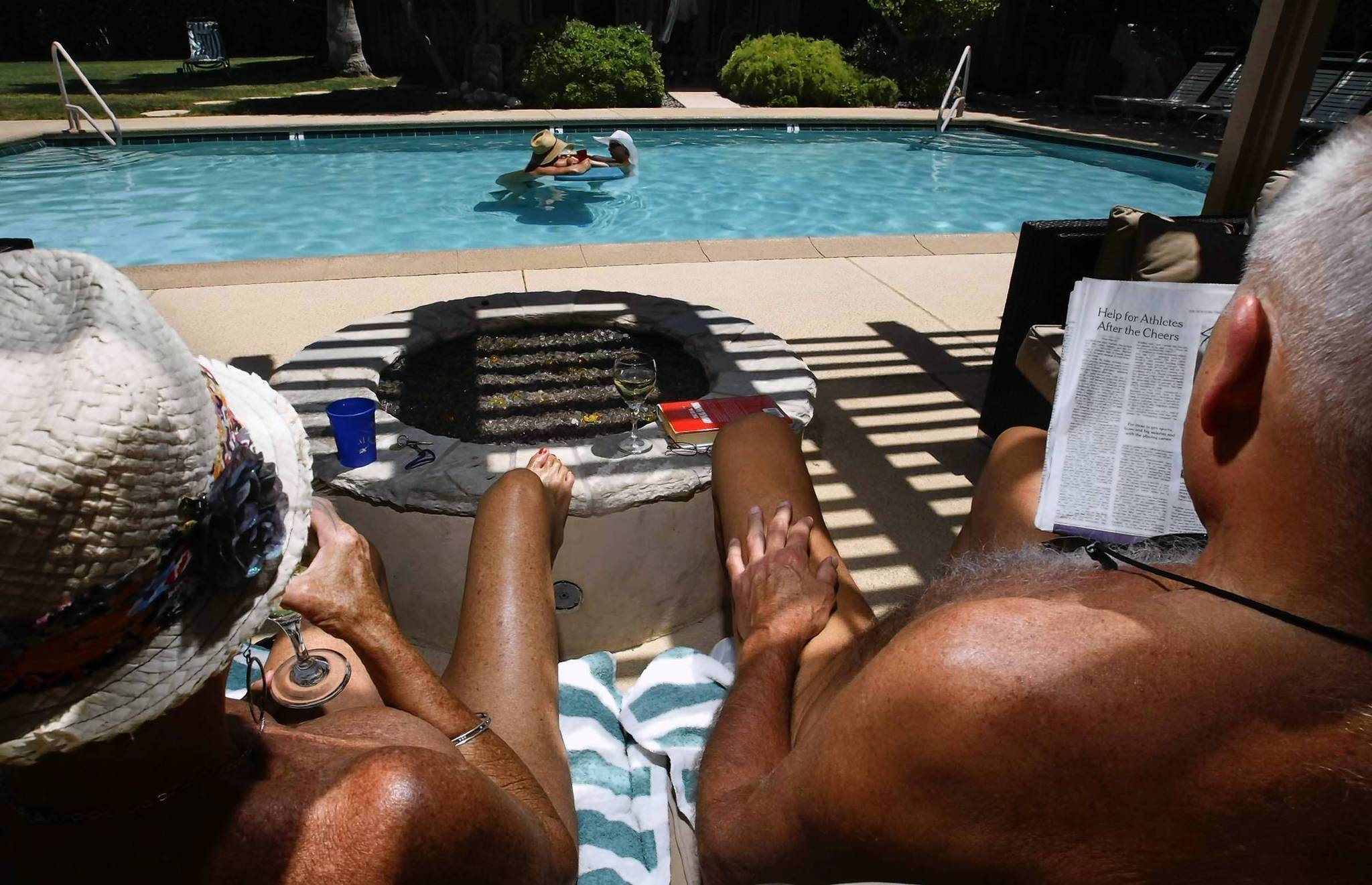 Judy and her husband, Mike, lounge by the pool at the Desert Sun nudist resort in Palm Springs. The Maryland couple have been making the resort their vacation destination for the last seven years. They agree with the owners' recent decision to ban children.