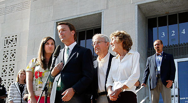 Former U.S. Sen. John Edwards (C) addresses the media alongside his daughter Cate Edwards and his parents Wallace and Bobbie Edwards at federal court May 31, 2012 in Greensboro, North Carolina. Edwards was acquitted on one count and a mistrial was declared on the five other counts after nine-days of jury deliberations in his corruption trial.