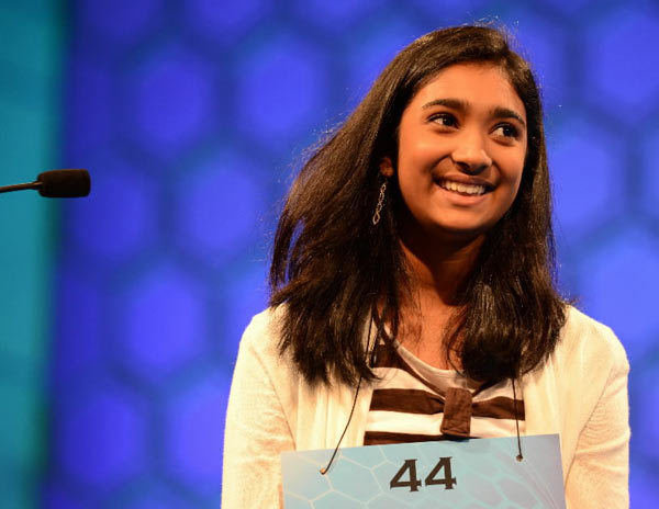 "Stuti Mishra, of West Melbourne, Florida, grins after spelling correctly ""sahel"" during the final rounds of the 2012 Scripps National Spelling Bee in National Harbor, Maryland, Thursday, May 31, 2012. The 8th-grader finished as the runner-up ni the bee."