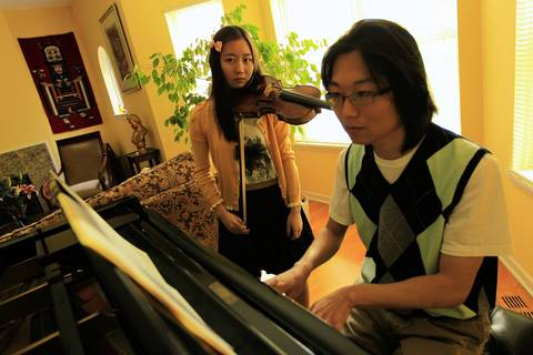Sayuri Yano, 15, practices with her brother Sho Yano in their Hyde Park home. After receiving her bachelor's degree in biology from Roosevelt University in 2010, she is now at Johns Hopkins University in Baltimore, pursuing a second B.A., this one in violin performance.