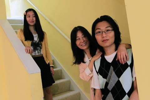 Sayuri Yano, 15, left, brother Sho Yano, 21, right, and their mother Kyung Yano in their Hyde Park home.