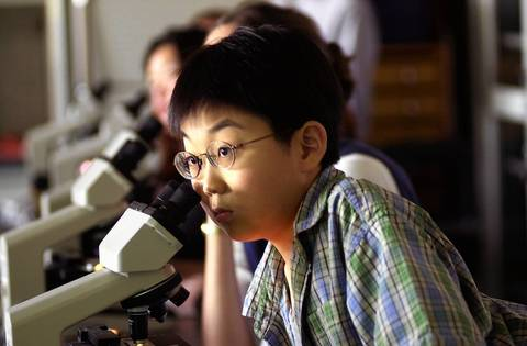At 9 years old, Sho Yano, who was enrolled as a freshman at Loyola University, studies general biology in Sept., 2000.