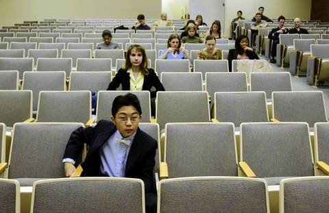 Sho Yano, 12, waits to present his biology research on April 28, 2003 at an undergraduate symposium at Loyola University.