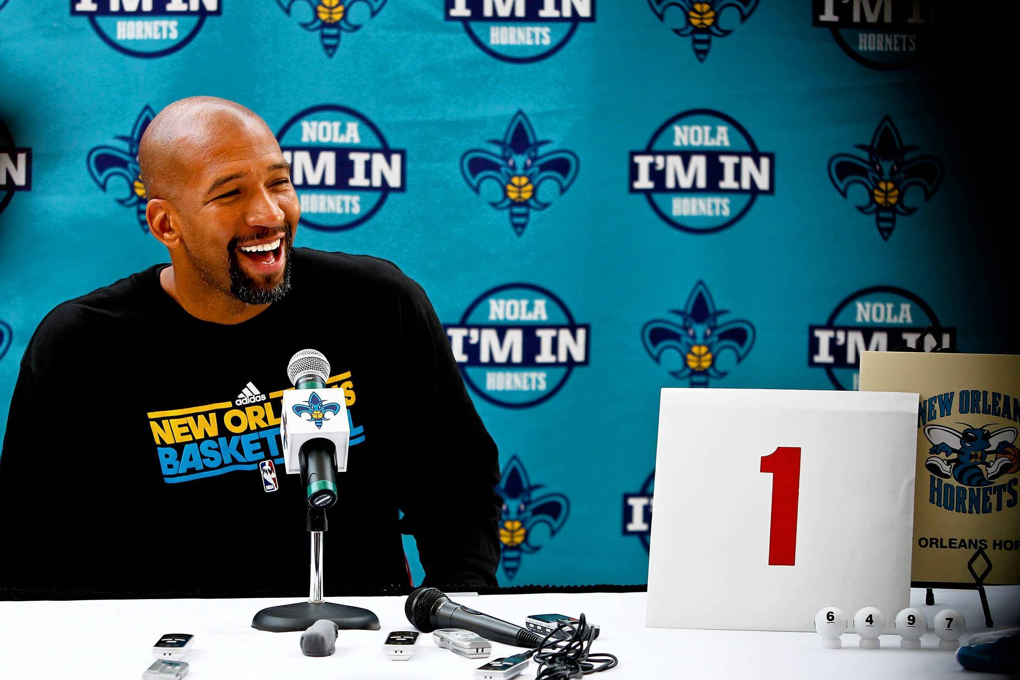 New Orleans Hornets head coach Monty Williams with the winning lottery ball combination (6-4-9-7) and the winning envelope from the NBA draft lottery during a press conference at the Alario Center on Friday. (Derick E. Hingle-US PRESSWIRE)