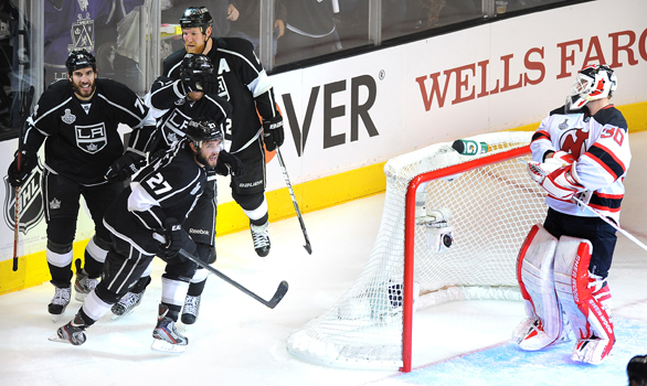 Kings defenseman Alec Martinez, left front, celebrates with his teammates after scoring on New Jersey goalie Martin Brodeur during the second period of the Kings' 4-0 victory in Game 3 of the Stanley Cup Final at Staples Center on Monday.