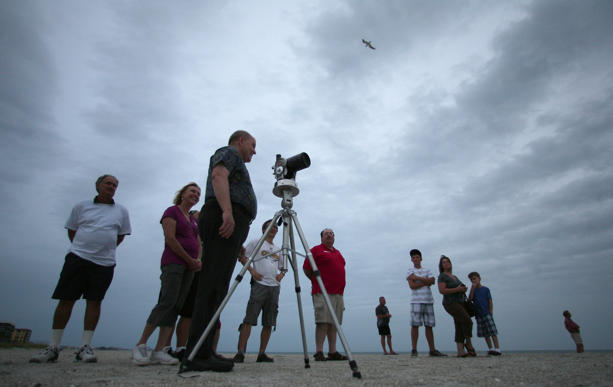Members of the St. Petersburg Astronomy Club along with several other attendees gather along the beach to watch the Venus Transit at The Old Snack Shack in Madeira Beach in St. Petersburg, Fla Tuesday, June 5, 2012.