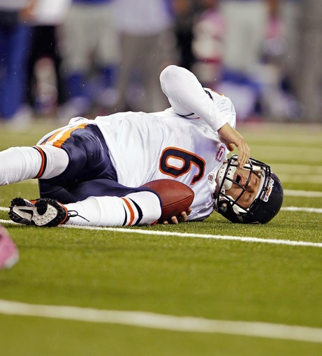 Jay Cutler lays on the ground after being sacked by the Giants' Aaron Ross in the second quarter. The hit apparently caused a concussion and Cutler was pulled from the game.