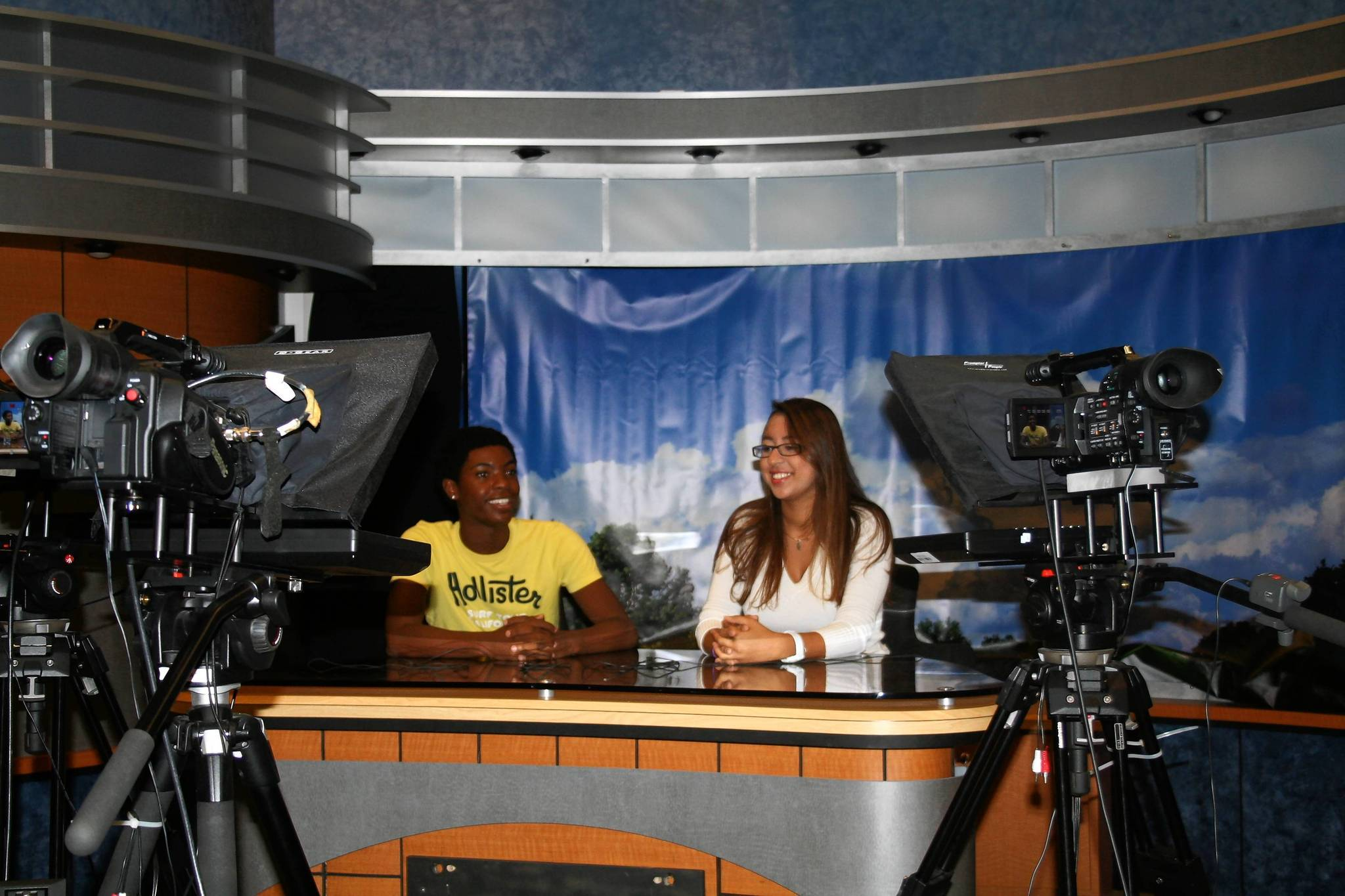 Zaikeus Malone and Abla Alaoui get practice as anchors in West Orange Highs TV production program. The school will take over funding the program after Westside Tech pulled out, but culinary and automotive programs at Apopka High will not survive.