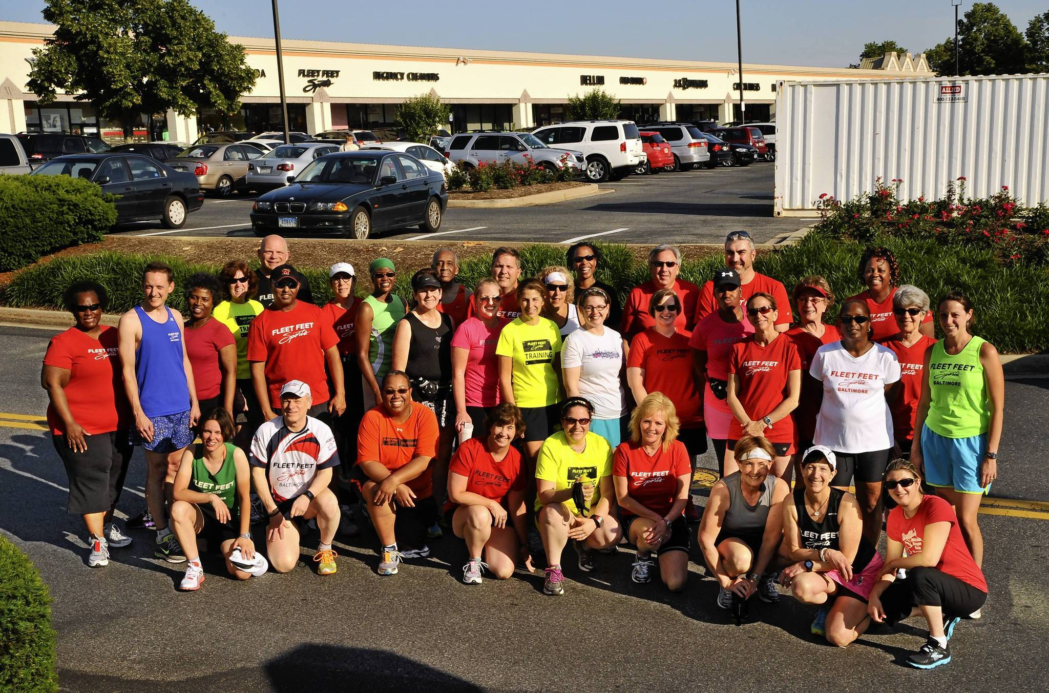 Runners meet at Fleet Feet Sports Baltimore on Tuesday and Thursday evenings. The group is organzied by store owners Bobby and Karen Levein (second from left, front row, and second from right, front row, respectively).