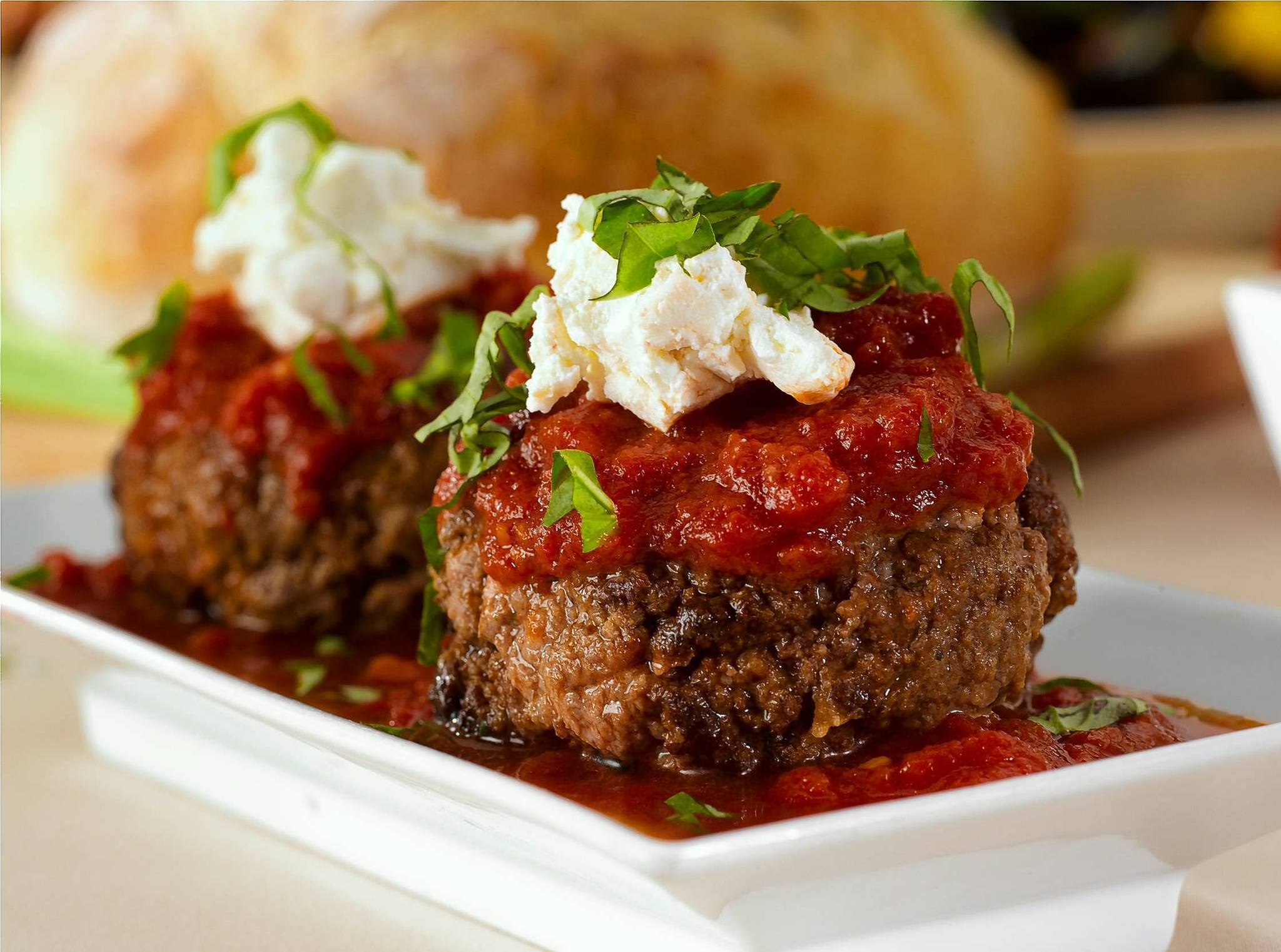 Don't visit Luca Bella without trying Mickey's meatballs, three tender meaty globes with bright-red tomato sauce and a dollop of creamy ricotta.