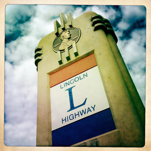 Lincoln Highway road marker in Dekalb. The original markers, designed by landscape architect Jens Jensen, were concrete with a bronze head of President Lincoln and the highway logo.