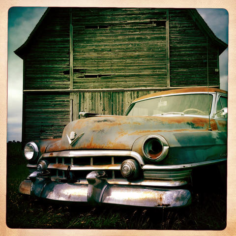 An old Cadillac in front of a barn on Lincoln Highway in Rochelle