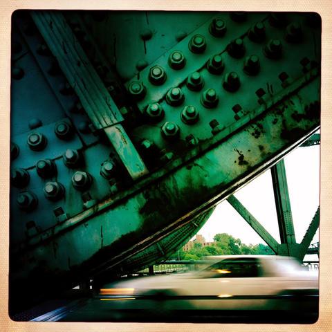 A car crosses the Cass Street Bridge in Joliet.