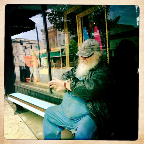 Jerry waits outside of SMLTWN Board Shop for his daughter before having breakfast across Lincoln Highway at the Lincoln Inn Restaurant in Dekalb.