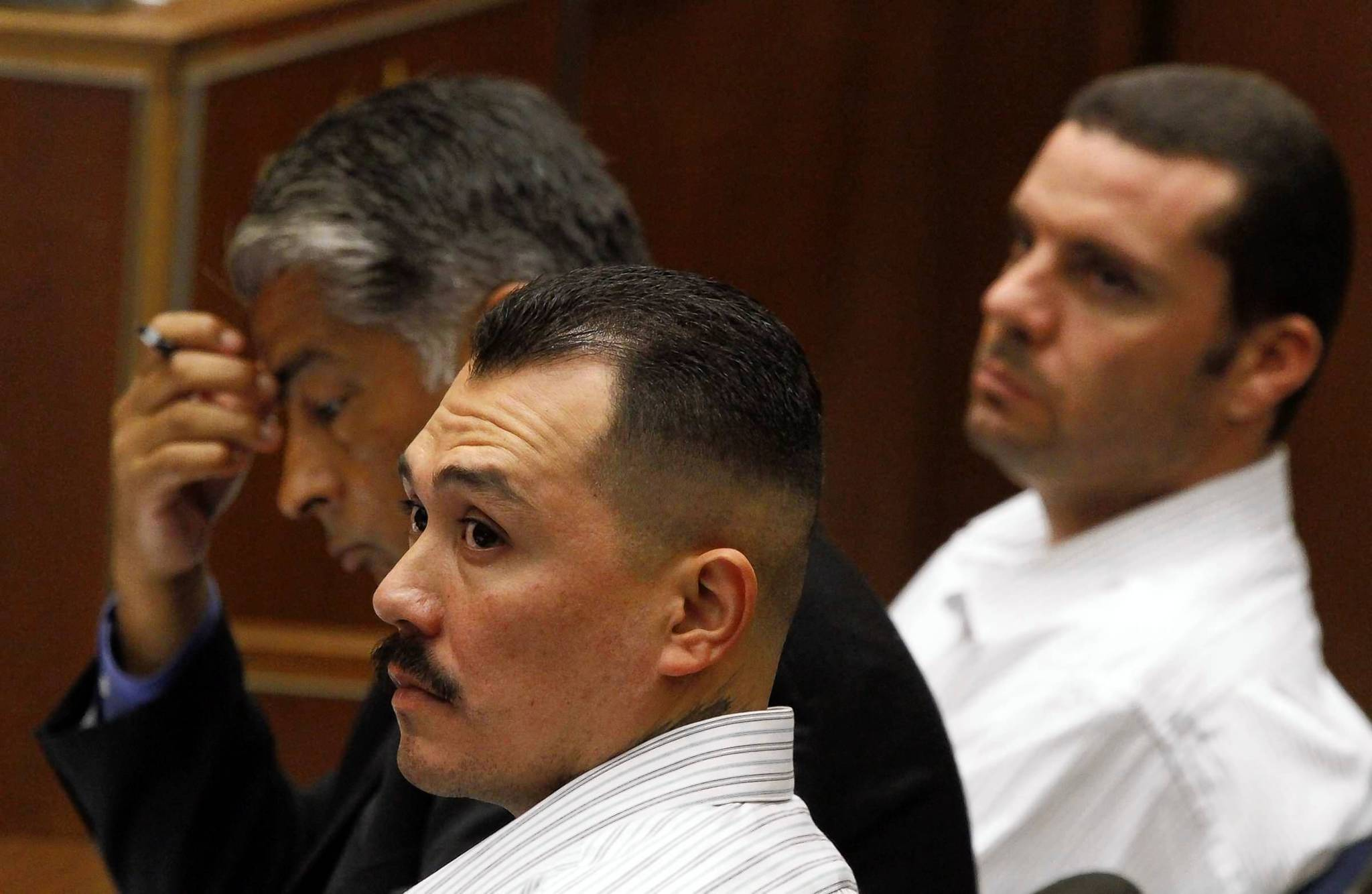 Marvin Norwood, right, his attorney Victor Escobedo and Louie Sanchez listen during the preliminary hearing on Friday.