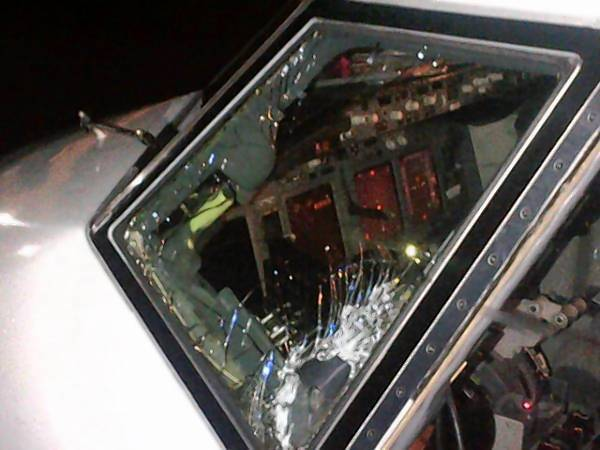 Photo posted on Twitter by University of Florida's Matt DeLancey showing the windshield of the Gators' chartered plane after it landed in Alabama. It cracked in midair, he said on Twitter.