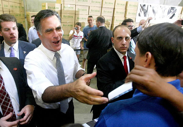 GOP presidential contender Mitt Romney greets supporters during an appearance at Con-Air Industries, an air filtration business, in Orlando, Florida, on Tuesday, June 12, 2012.