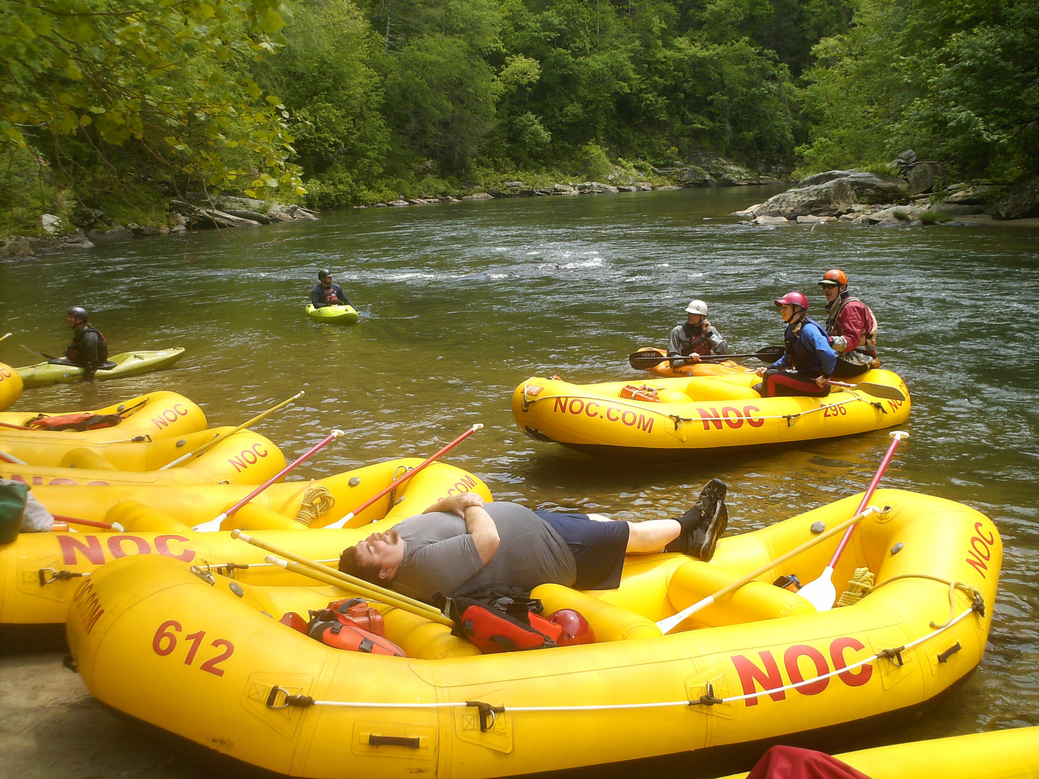 Paddlers take a break along the banks of the Chattooga River on a recent white water trip with the Nantahala Outdoor Center.