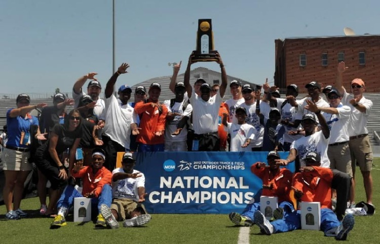 Members of the Florida Gators mens track team and coach Mike Holloway pose with the championship trophy after winning the team title in the 2012 NCAA Track & Field Championships at Drake Stadium.