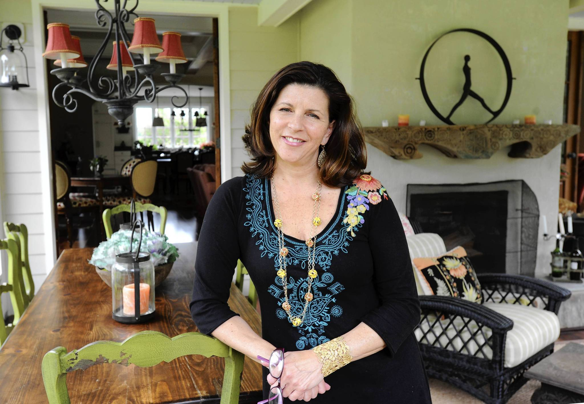 Kim Eastburn on the porch of her dream home in Monkton.