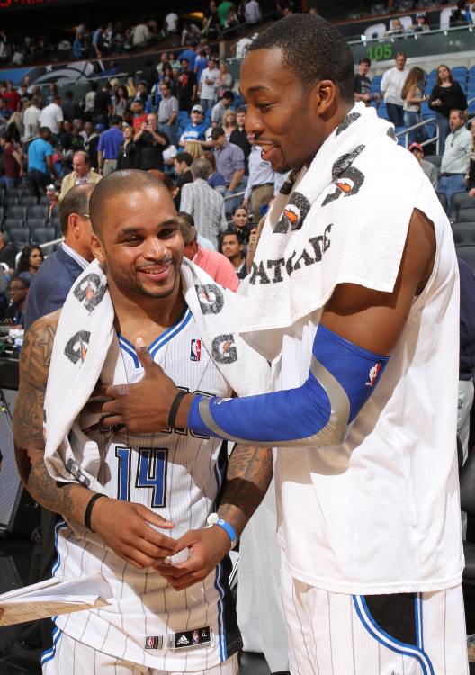 Orlando guard Jameer Nelson and Dwight Howard celebrate the Magic's 86-70 victory over the New Jersey Nets in Orlando, Fla. Friday, March 16, 2012.