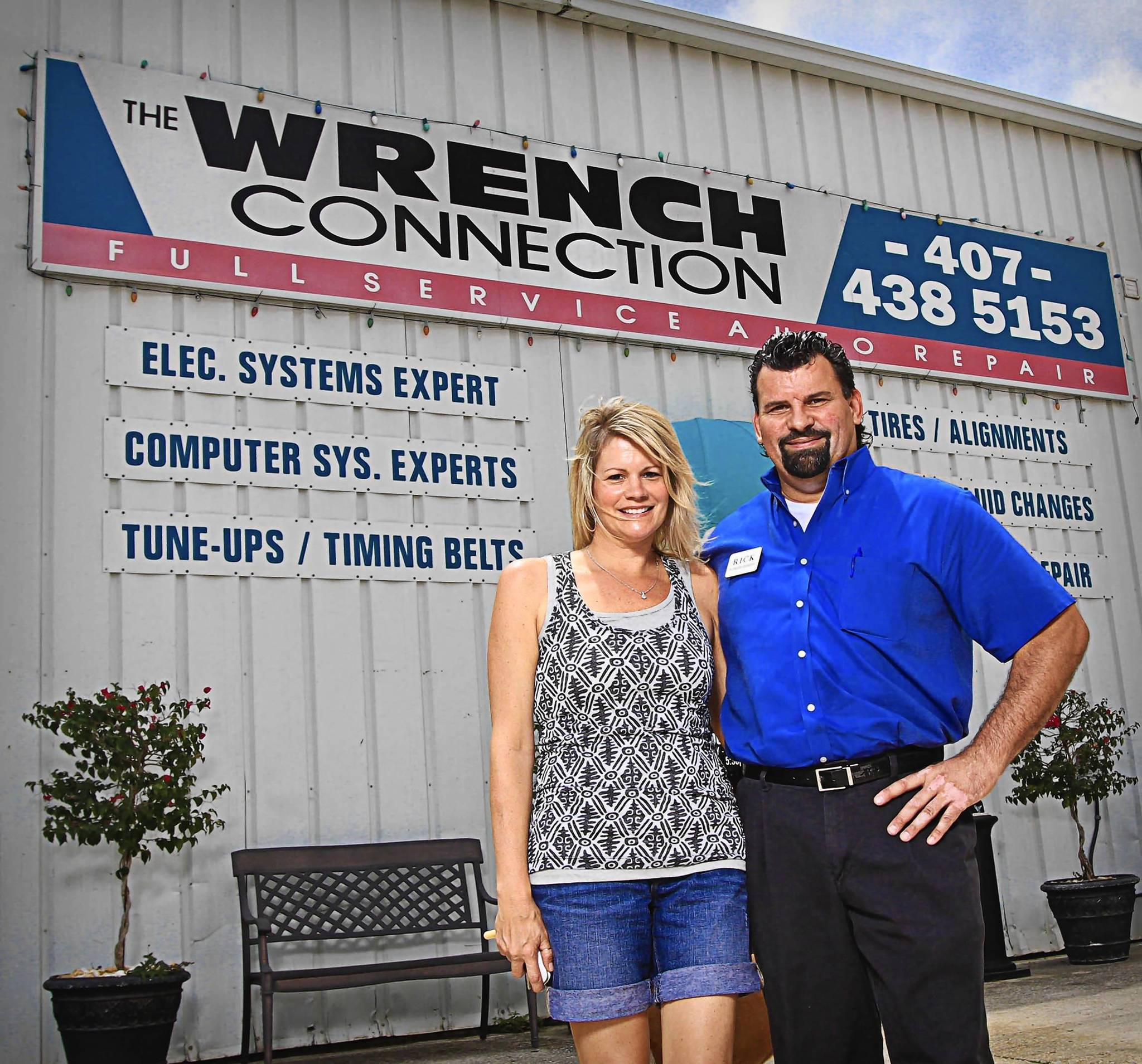 Rick Eakins, the owner of Wrench Connection, poses for a photo with his wife, Diane, at his business in Orlando on Thursday.