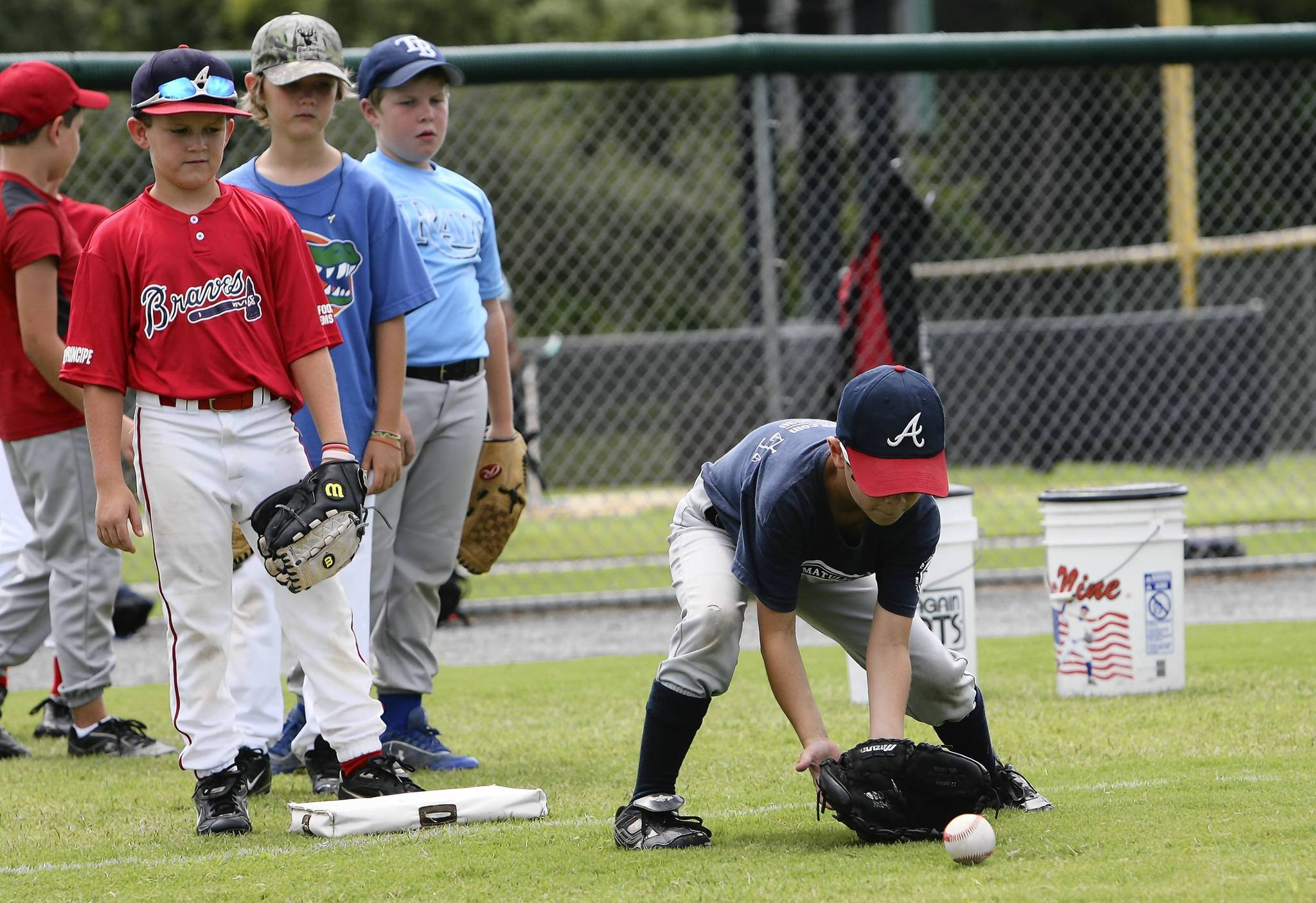 Lake-Sumter Community College baseball coach Rich Billings, teaches 8-12 year olds  on Monday, June 11, 2012. During the Mike Matulia All-Star baseball school summer session at the LSCC athletic campus in Leesburg. (Tom Benitez/Orlando Sentinel