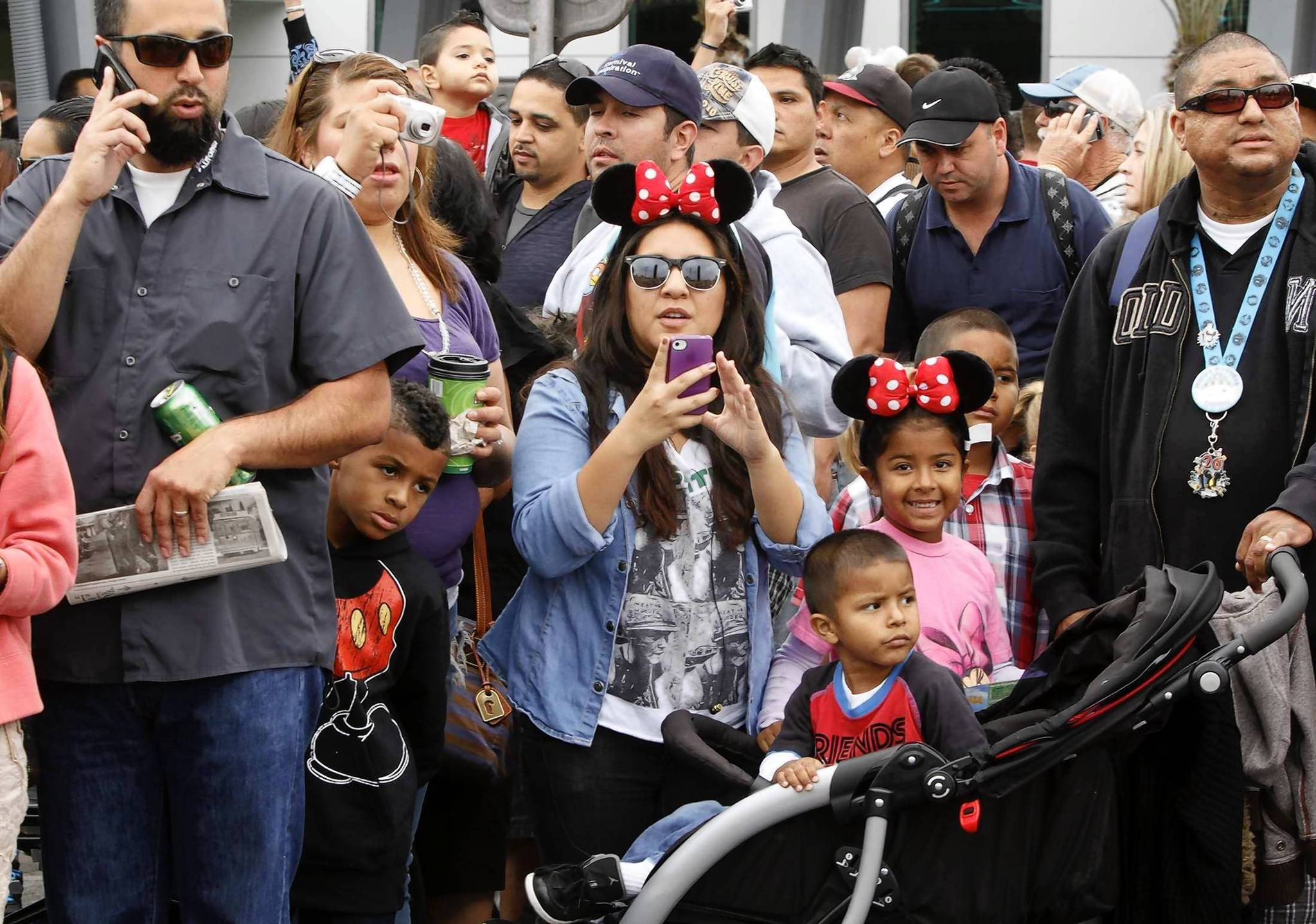Disney officials declined to disclose attendance numbers for Disney California Adventure Park, but Al Lutz, founder of the online Disney blog Miceage.com, reported Monday that the park drew a record 43,000 visitors Friday, opening day for its new Cars Land expansion. Above,  visitors crowd onto Route 66 in Cars Land, where three new rides, shops and restaurants opened to the public Friday.