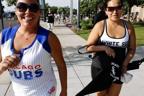 Maritza Roja (left) with her best friend Micaela Ramirez make their way to U. S. Cellular Field.