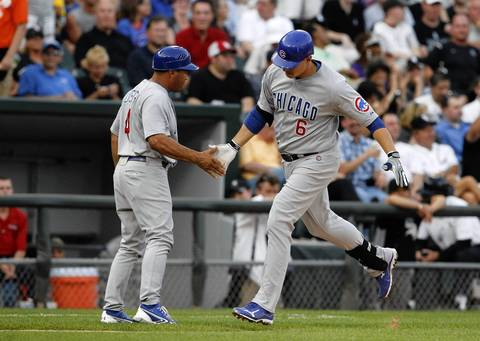 Third base coach Pat Listach congratulates Bryan LaHair after his two-run homer during the third inning.