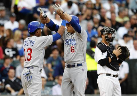 Starlin Castro high-fives Bryan LaHair after his two-run home run during the third inning.