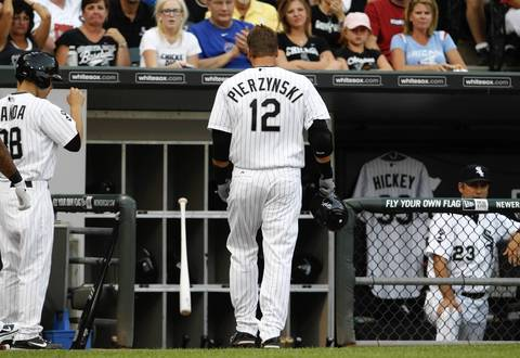 A.J. Pierzynski throws his bat in the dugout after striking out against the Cubs during the 2nd inning.