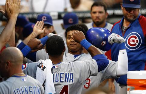 Starlin Castro flexes his biceps in the dugout after hitting his two-run homer against the Sox during the fifth inning.